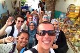 Students in a group photo in the Rabat medina
