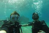 Students scuba dive in the Red Sea near Aqaba, Jordan