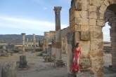 A student poses with the Ruins at the Roman city of Volubilis