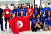 A group of YES students hold the Tunisian flag